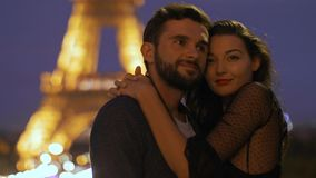 FRANCE, PARIS - OCT 2, 2017: Romantic Couple in love in Paris at Eiffel Tower in Night. stock video footage