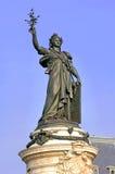France, paris: Place de la Republique. Blue sky and a bronze statue representing the republic royalty free stock photography