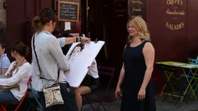FRANCE, PARIS Talanted painter drawing picture of woman, Montmartre stock footage