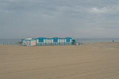 France - Perpignan. Blue and white wooden beach restaurant on the beach of Perpignan against a cloudy sky Royalty Free Stock Photo