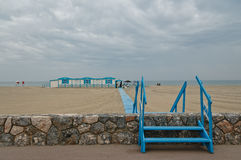 France - Perpignan. Blue and white wooden beach restaurant on the beach of Perpignan against a cloudy sky Royalty Free Stock Photography