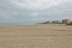 France - Perpignan. Coastline view of the beach at Perpignan against a cloudy sky Royalty Free Stock Images
