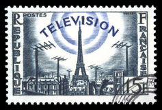 France postage stamp television development. France postage stamp showing an engraving of television development broadcasting from the Eiffel Tower Stock Photography