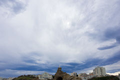 France, Pyrénées-Atlantiques, Biarritz, the rock of the virgin under a sky of storm Royalty Free Stock Image