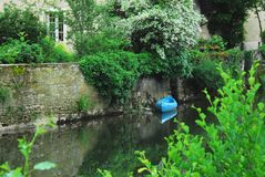 France- Reflections Along the Serein River in Noyers. Beautiful Medieval Noyers-Sur-Serein in Burgundy, France.  Reflections along the river Royalty Free Stock Photography