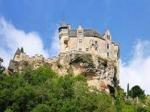 France's Chateau de Montfort. The Chateau de Montfort rises above cliffs and forests stock image