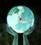 France on blue globe in hands. France on shiny blue globe in hands in space. 3D illustration royalty free stock images