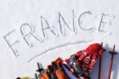 France ski vacation background, equipment, clothes, poles, word written in snow Stock Photo
