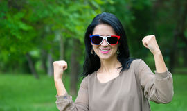 France soccer fan with funny sun glasses over green Royalty Free Stock Photography