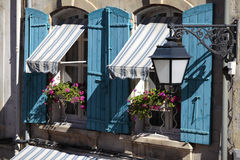 France south provence style cottage windows, blue shutters and flower boxes Royalty Free Stock Photo