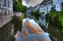 France Strasbourg water channel sunset. France Strasbourg water channel with sky and clouds reflection Royalty Free Stock Photo