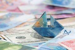 France suíço dobrado como o barco em moedas do mundo Foto de Stock
