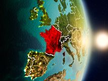 France during sunrise. Highlighted in red on planet Earth with visible country borders. 3D illustration. Elements of this image furnished by NASA Royalty Free Stock Photos