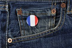 France Supporter. A pin on denim trousers, identifying a France supporter or travelling to France concept Royalty Free Stock Photos