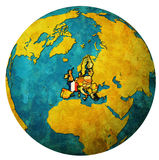 France territory with flag over globe map. France location with national flag over territory of european union member countries on globe map isolated over white Stock Images
