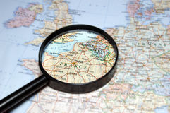 France under magnifier. Paris, London and Brussel on the map under magnifier Royalty Free Stock Images