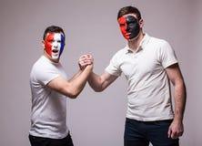 France vs Albania. Football fans of national teams friendly handshake Royalty Free Stock Photos