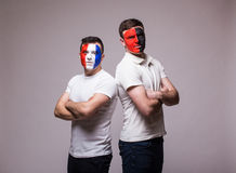 France vs Albania. Football fans of national teams before match on grey background. Stock Image