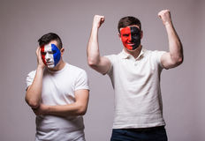 France vs Albania on grey background. Football fans of national teams demonstrate emotion: France lose, Albania win. Stock Images