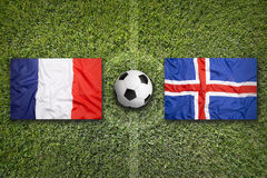 France vs. Iceland flags on soccer field Stock Images