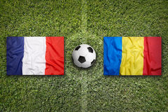 France vs. Romania flags on soccer field Stock Images