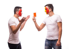 France vs Romania. Football fan of  Romania national teams show red card to France fan Royalty Free Stock Photo