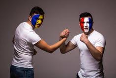 France vs Romania. Football fans of national teams handshake before match Stock Photo