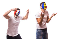 France vs Romania on white background. Football fans of Romania  and France national teams demonstrate emotions: Romanian lose, Fr Stock Photos