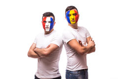 France vs Romania on white background. Football fans of Romania  and France national teams look at camera Stock Photos