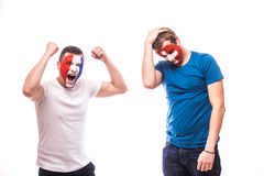 France vs  Switzerland. Football fans of national teams demonstrate emotions: Swiss lose, France win. Stock Photos