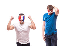 France vs  Switzerland. Football fans of national teams demonstrate emotions: Swiss lose, France win. Royalty Free Stock Image