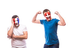 France vs  Switzerland. Football fans of national teams demonstrate emotions: Swiss win, France lose. Royalty Free Stock Photo
