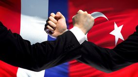 France vs Turkey confrontation, countries disagreement, fists on flag background. Stock photo stock photography