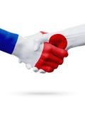 Frances de drapeaux, pays du Japon, concept de poignée de main d'amitié d'association Photo stock