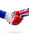 Frances de drapeaux, pays du Royaume-Uni, concept de poignée de main d'amitié d'association Images stock