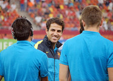 Francesc Fabregas of Barcelona smiles to his teammates. Francesc Fabregas smiles to his teammates before a football game between FC Barcelona and Dinamo Royalty Free Stock Photos