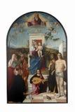 Francesco Bissolo : Madonna avec l'enfant, les saints et le donateur images libres de droits