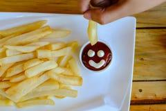 Francese fritto e pollo Fotografie Stock