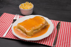 Francesinha and french fries Stock Photos