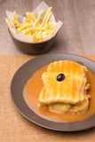 Francesinha and french fries Stock Images