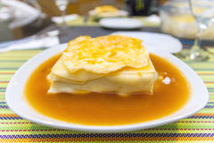 Francesinha with hot sauce. And egg Stock Image