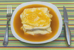 Francesinha with hot sauce. And egg Royalty Free Stock Image