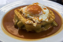 Francesinha - Portuguese sandwich from Porto. Francesinha on a plate in Porto in Portugal royalty free stock photos