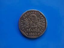 2 franchi di moneta, Francia sopra il blu Fotografia Stock Libera da Diritti
