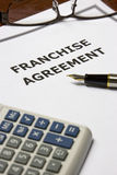 Franchise Agreement. Image of a franchise agreement on an office table Royalty Free Stock Photos