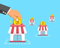 Franchise business concept hand putting coin in stores. For design Stock Photo