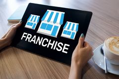 Franchise business model and growth concept on device screen. Franchise business model and growth concept on device screen royalty free stock image