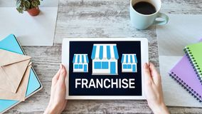 Franchise business model and growth concept on device screen. Franchise business model and growth concept on device screen royalty free stock images