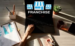 Franchise business model and growth concept on device screen. Franchise business model and growth concept on device screen stock photography