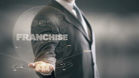 Franchise Businessman Holding in Hand New technologies